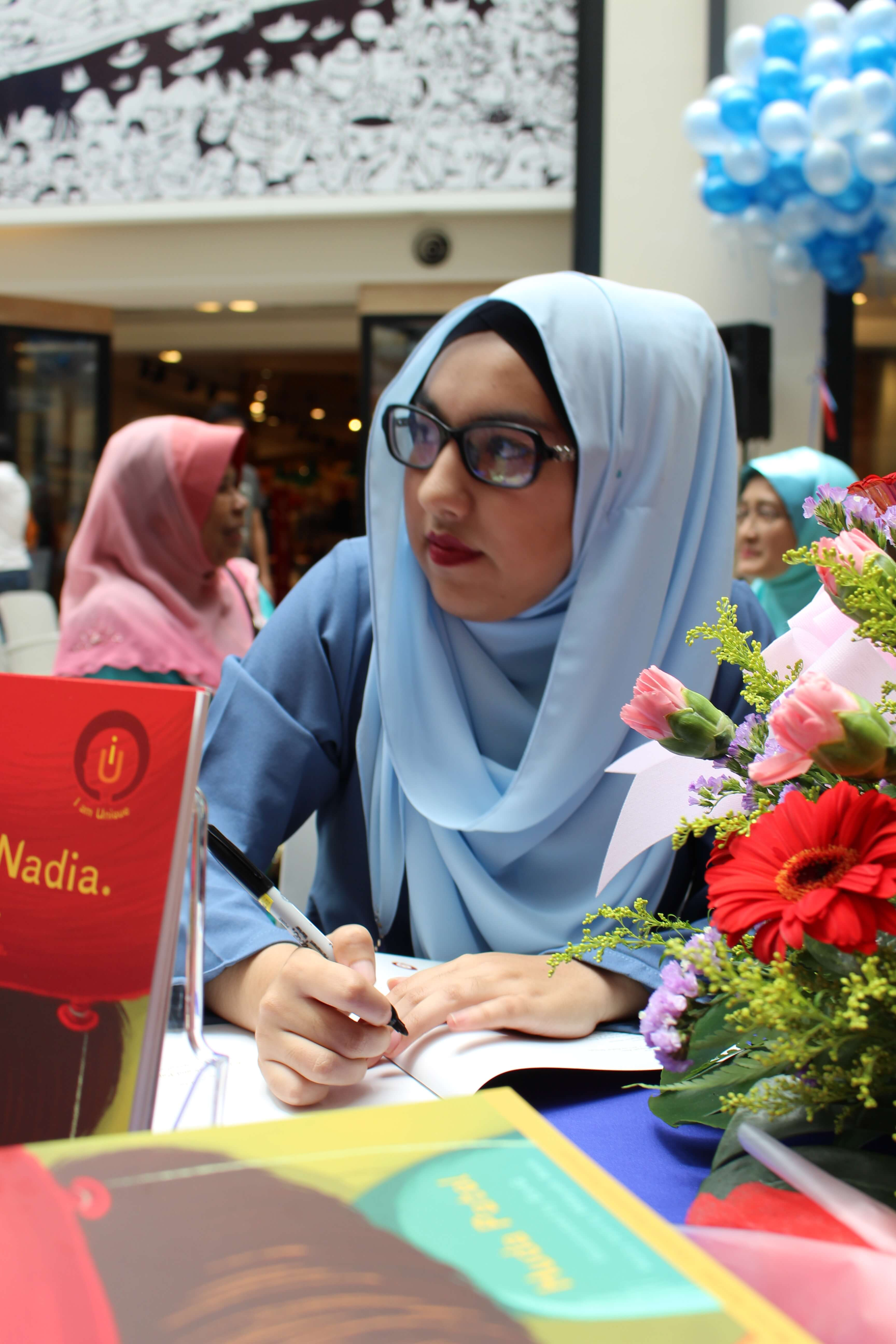 Huda Patel signing on her debut book during the book launch at Publika Shopping Mall