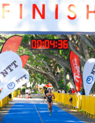 Zoe crossing the finishing line in a race held in Singapore